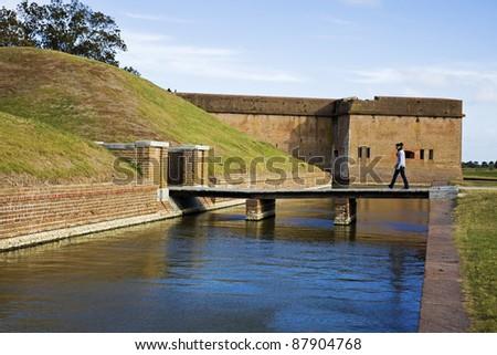 Tourist walking to Fort Pulaski, Georgia - stock photo