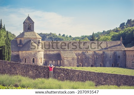Tourist watching the beautiful abbey of Senanque, France - stock photo