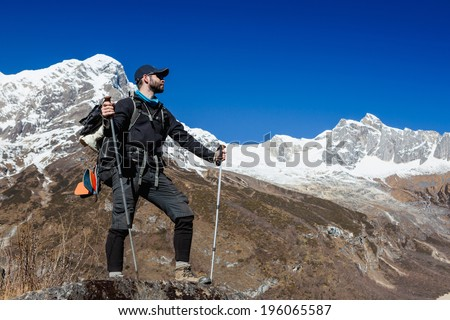Tourist with a backpack and mountain panorama. Himalayas  - stock photo