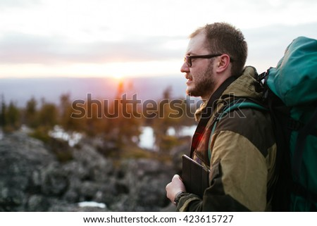 tourist with a backpack in the mountains, snow - stock photo