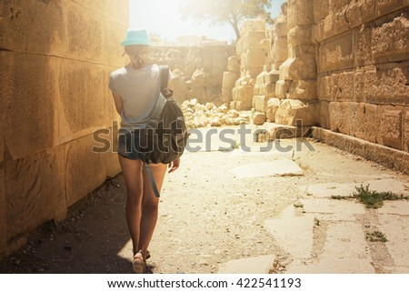 tourist woman at the ruins  - stock photo