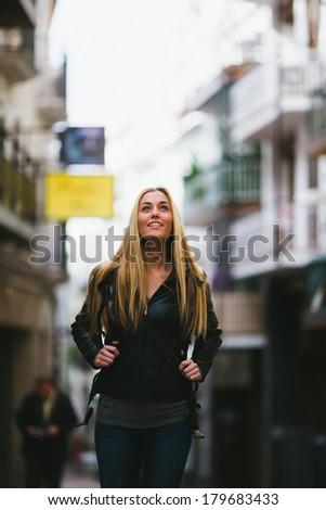 Tourist woman walking around the city - stock photo