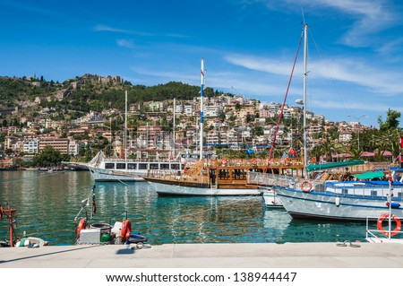 tourist yachts in the harbor by the sea - stock photo