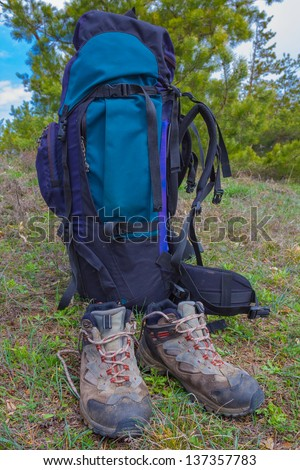 touristic boots and a backpack - stock photo