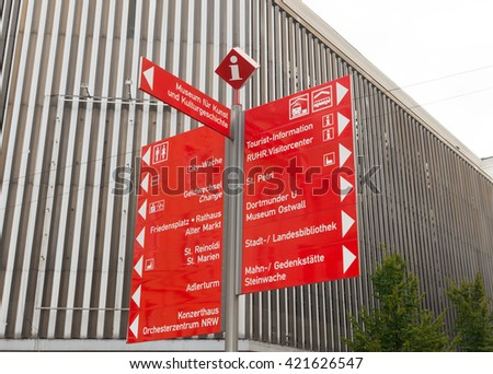 touristic red signpost in the center of Dortmund, Germany - stock photo