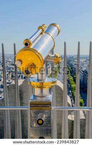 Touristic telescope placed in the Arc de Triomphe, Paris, France - stock photo
