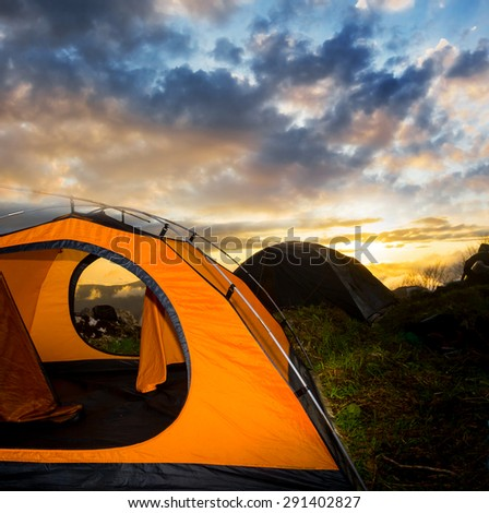touristic tent at the sunset - stock photo