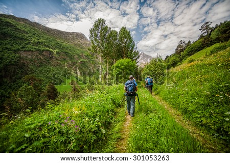 Tourists and climbers with trekking pole are on the mountain Cheget, Kabardino-Balkaria Republic, Russia. Caucasus Mountains - stock photo