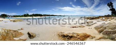 Tourists and holidaymakers on vacation enjoying the water and surrounds at Currarong. 180 scenic views where Currarong creek joins the beach.    Panorama - stock photo