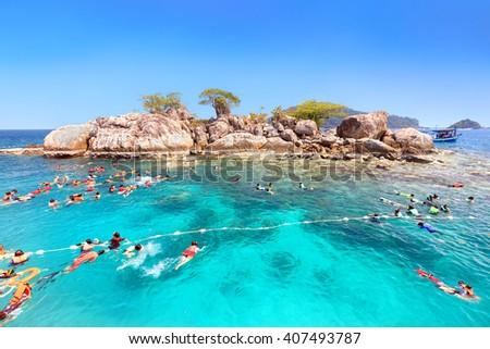 Tourists are enjoy snorkeling underwater at Koh Yak Lek (Island near Koh Chang in Trat, Thailand) - stock photo