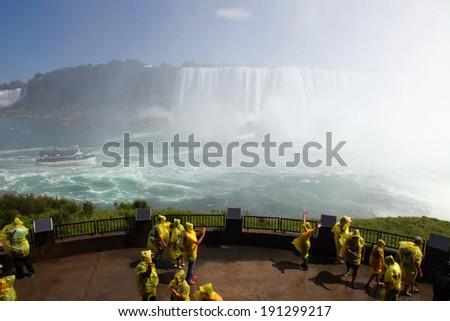 Tourists at Niagara Falls, shallow focus - stock photo