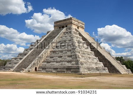 Tourists climb the top of the pyramid, highest Maya structure standing 40 Meters above the Yucatan jungles. - stock photo
