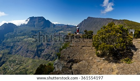Tourists enjoy a beautiful view into the interior of Reunion Island in the Cirque de Mafate - stock photo