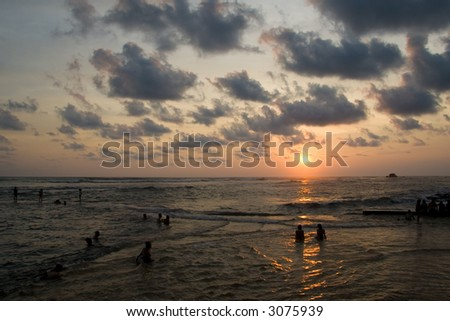 Tourists enjoying the the sunset in El Salvador - stock photo