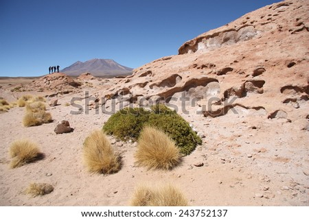 Tourists explore Ollague Volcano in Eduardo Avaroa National Park, Potosi, Bolivia - stock photo