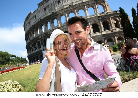 Tourists holding visitor's museum pass in Rome - stock photo