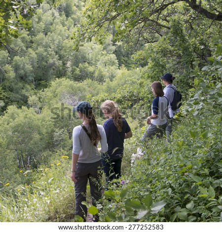 Tourists in a forest, Riding Mountain National Park, Manitoba, Canada - stock photo