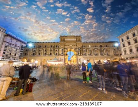 Tourists in Piazza della Repubblica. Republic Square in Florence, Italy. - stock photo