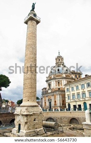 Tourists in Piazza Venezia on a cloudy day in Rome, Italy; Trajan's Column - stock photo