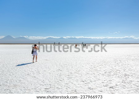 Tourists in saline lagoon near San Pedro de Atacama - Chile, Latin America - stock photo