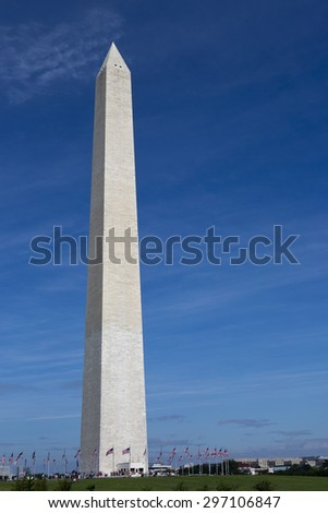Tourists line up to visit the Washington Monument in Washington, D.C., USA. - stock photo