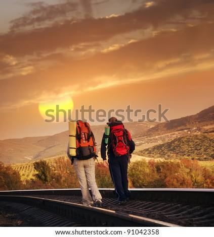 tourists on railroad - stock photo