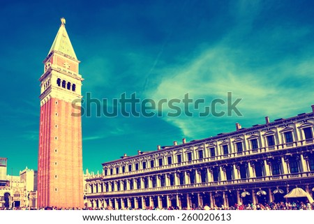 Tourists on San Marco square with Campanile and Doge Palace. Venice, Italy.  Instagram like filter - stock photo