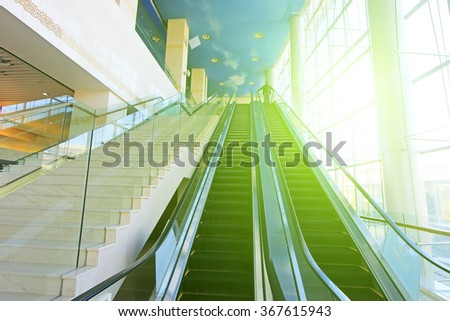 tourists on the escalator in a shop, closeup of photo - stock photo