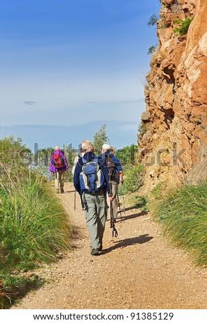 Tourists practising trekking in Majorca (Spain) - stock photo