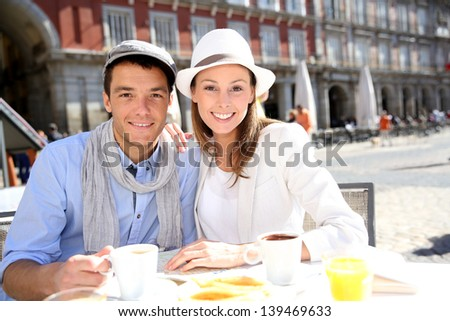 Tourists sitting at coffee shop in la Plaza Mayor, Madrid - stock photo