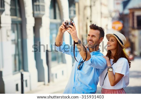 Tourists taking photo in the city - stock photo