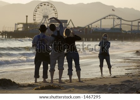 Tourists taking pictures at the Santa Monica Pier - stock photo