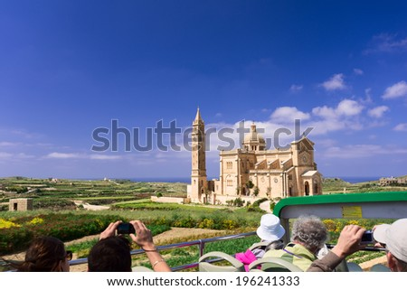Tourists taking pictures of The National Shrine of the Blessed Virgin of Ta' Pinu, Gozo, Malta - stock photo