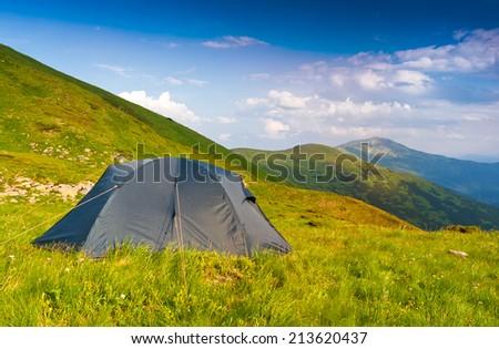 Tourists tent in Carpathian mountains - stock photo