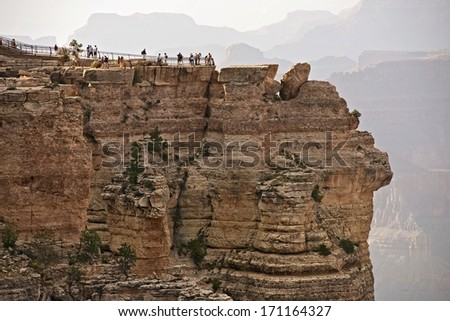 Tourists Visiting Grand Canyon in Summer Time. One of the Grand Canyon View Points. - stock photo