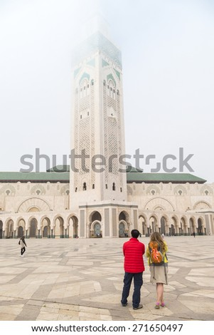 Tourists visiting Hassan II Mosque or Grande Mosquee Hassan II in Casablanca, Morocco, by misty morning - stock photo