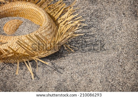Tourists went home. Hat lying on the beach - garbage - stock photo