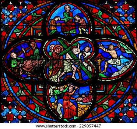TOURS, FRANCE - AUGUST 14, 2014: Stained glass window dating from the 13th Century in the Cathedral of Tours, France. This window depicts Jesus on the Via Dolorosa in the center. - stock photo