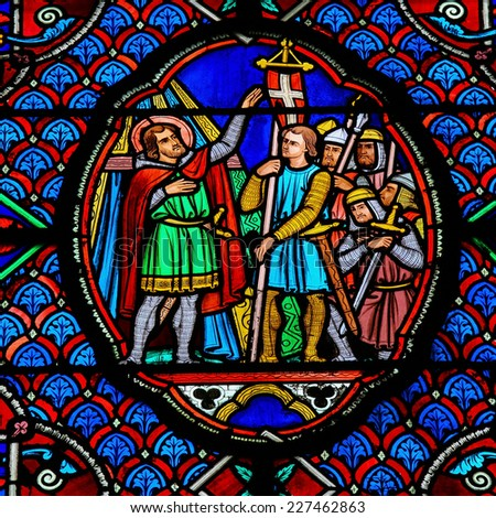 TOURS, FRANCE - AUGUST 8, 2014: Stained glass window depicting a catholic king speaking to his soldiers in the Cathedral of Tours, France. - stock photo