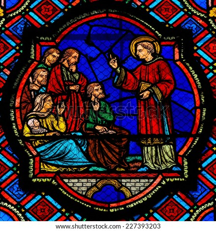 TOURS, FRANCE - AUGUST 8, 2014: Stained glass window depicting a Saint preaching in the Cathedral of Tours, France. - stock photo