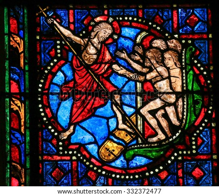 TOURS, FRANCE - AUGUST 14, 2014: Stained glass window depicting Jesus Christ saving mankind in the Cathedral of Tours, France. - stock photo