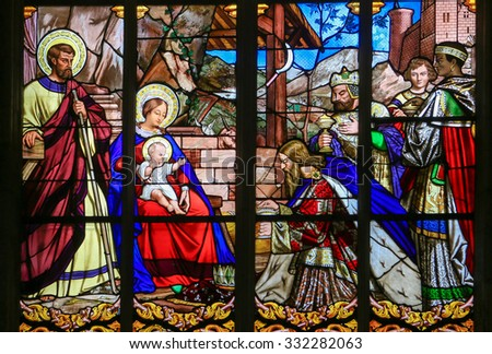 TOURS, FRANCE - AUGUST 14, 2014:  Stained glass window depicting the Epiphany, the Visit of the Three Kings in Bethlehem, in the Cathedral of Tours, France. - stock photo