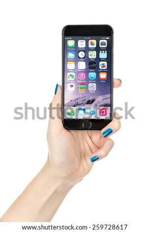 TOURS, FRANCE - February 6 2015: Female hand holding iPhone 6 Space gray variant isolated on white. iPhone 6 is a smartphone running iOS, developed by Apple Inc. - stock photo