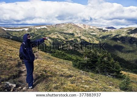 Toursit in Rocky Mountain National Park. - stock photo