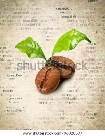Tow coffee beans with green leaves on a background of aged paper with the word coffee repeated multiple times in different languages - stock photo