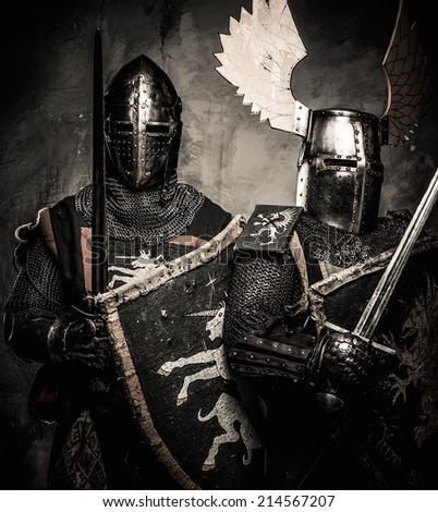 Tow medieval knights in full armour - stock photo
