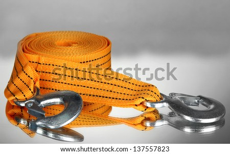 Tow rope for car on grey background - stock photo