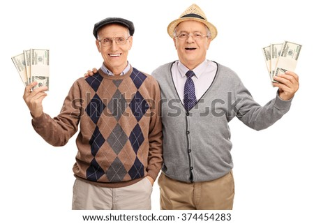 Tow senior gentlemen holding several stacks of money and posing together isolated on white background - stock photo