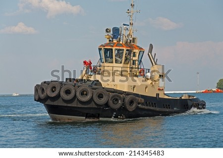 Tow Ship in the harbor of seaport. Closeup. - stock photo