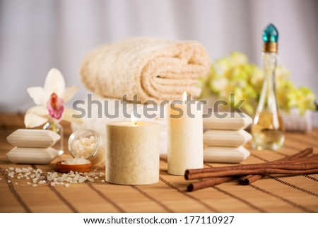 Towel, aromatic candles and other spa objects to free your mind. - stock photo